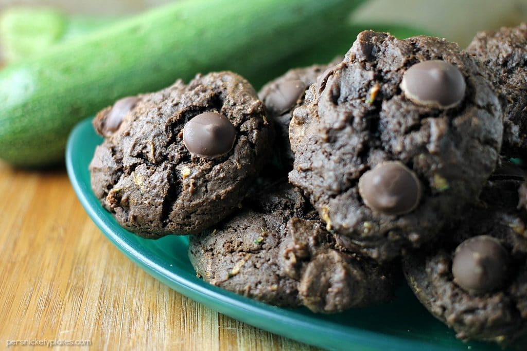 Chocolate Zucchini Drop Cookies are a sweet way to use up some of your zucchini crop. You end up with a moist, chocolatey cookie that's filled with chocolate chips but you don't even have to get out your mixer! | Persnickety Plates