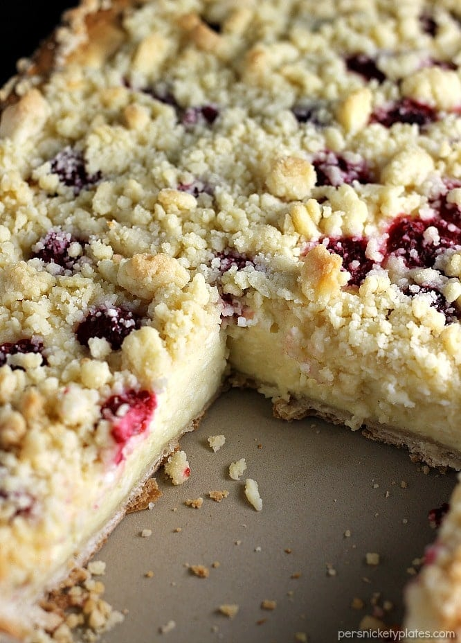 Raspberry Cream Cheese Crumb Cake is layered with a creamy cheesecake , fresh raspberries, and topped with a crunchy streusel topping. Perfect for brunch or dessert! | Persnickety Plates