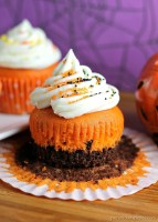 """Brownie Bottom Halloween Cupcakes have a layer of dark chocolate brownie topped with orange cake batter and finished off with buttercream and sprinkles. They are the perfect mix of semi-homemade and """"from scratch"""" to be easy but really fun and festive for your next Halloween party!   Persnickety Plates"""