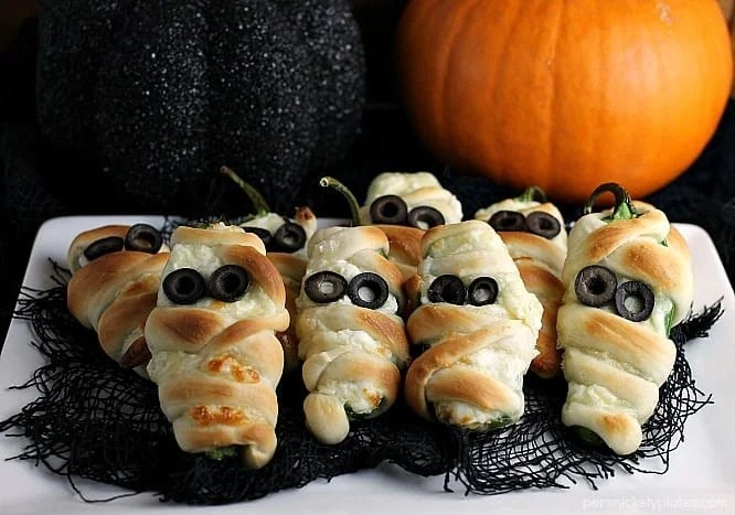 "Jalapeno Popper Mummies wrapped in Rhodes bread ""bandages"" make a spicy and spooky treat for your next Halloween party! 