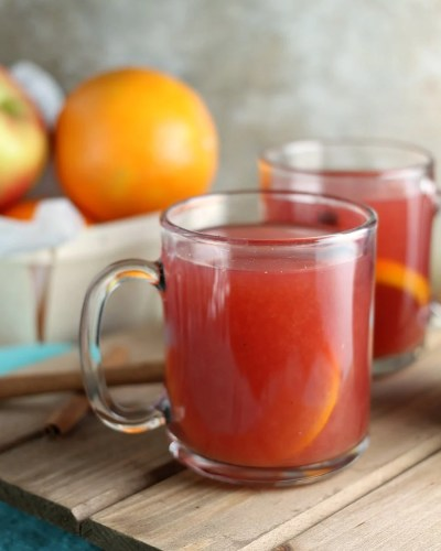 Cranberry Orange Cider only takes about 15 minutes to make and is perfect for all the winter and holiday activities that leave you cold and in need of warming up! | www.persnicketyplates.com