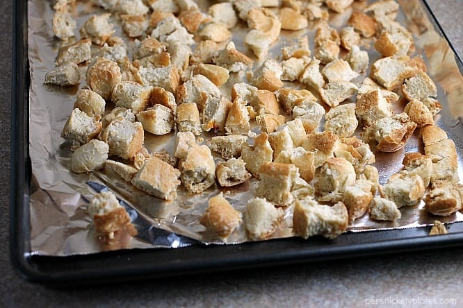 dried bread on baking sheet for herb stuffing