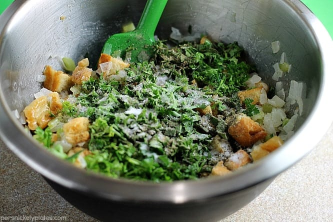 herbs and bread in mixing bowl