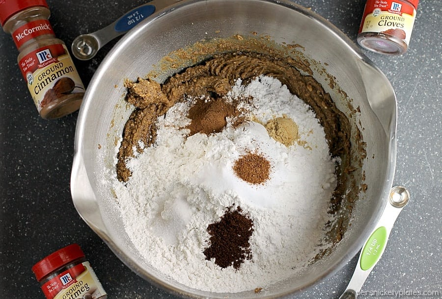 mixing bowl filled with ginger snaps ingredients