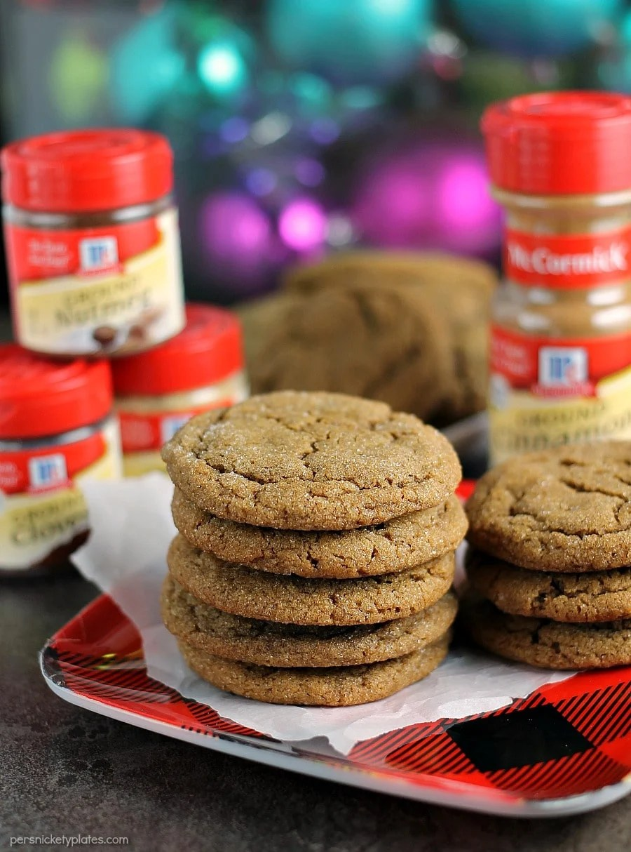 stack of ginger snap cookies with spices in background