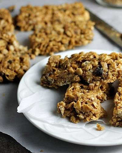 No Bake Chewy Granola Bars filled with peanut butter, honey, raisins, dates, and pecans are a healthy start to your day. With only five ingredients, you can whip them up in no time! | www.persnicketyplates.com