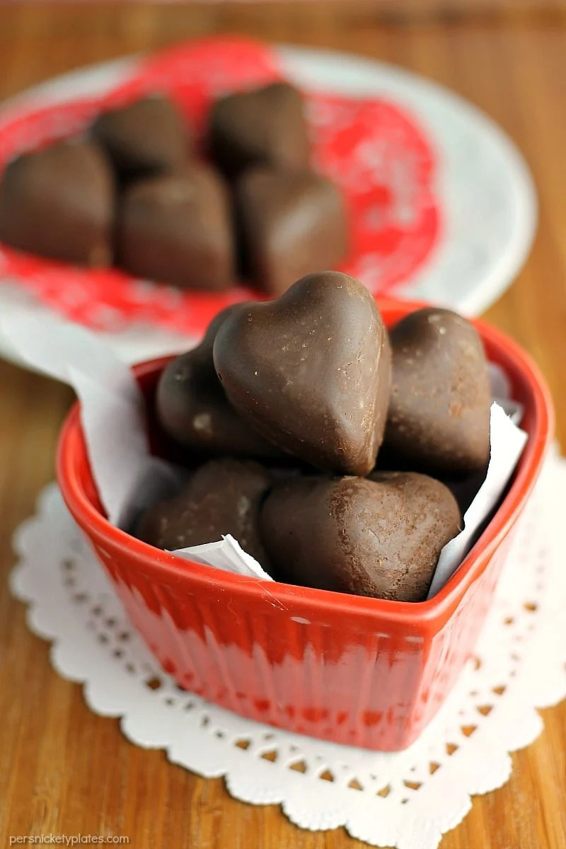 Dark Chocolate Toasted Almond and Coconut Hearts are a sweet, homemade goody perfect for Valentine's Day or anytime you want to treat yourself. | www.persnicketyplates.com