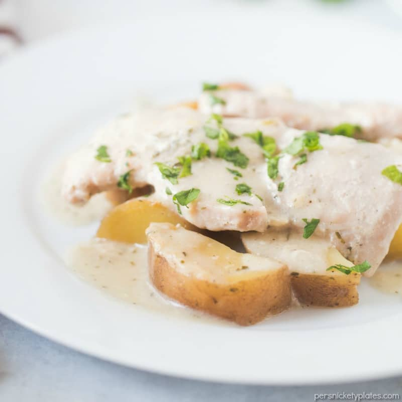 ranch pork chops & potatoes on white plate