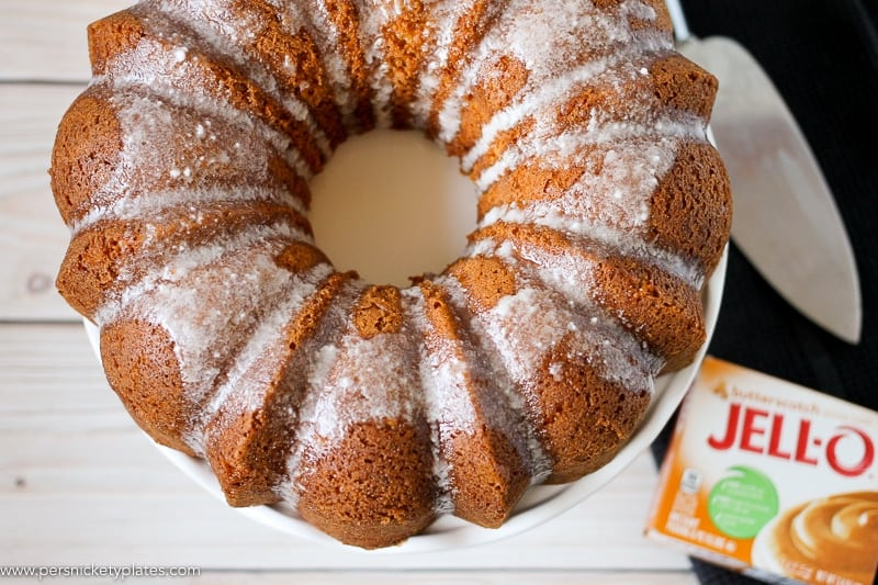 Overhead shot of butterscotch bundt cake on a cake plate with jello