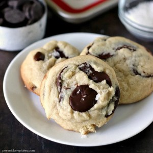 closeup of three Salted Chocolate Chip Cookies on a white plate