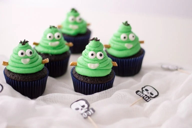 cupcakes topped with frankenstein poop emojis
