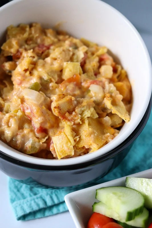 closeup of cheesy king ranch chicken in white bowl