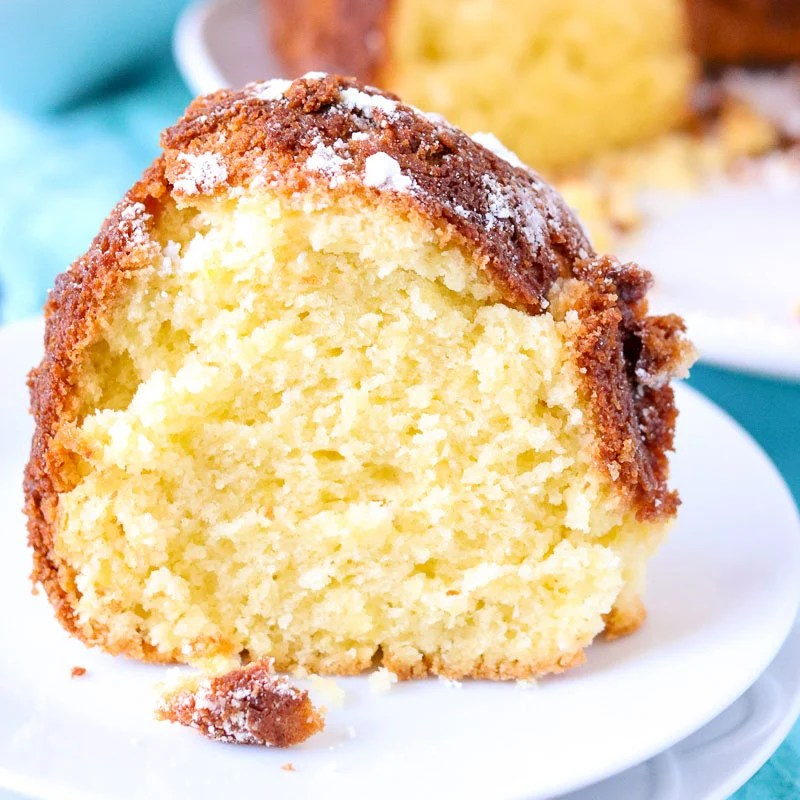 slice of lemon bundt cake on white plate