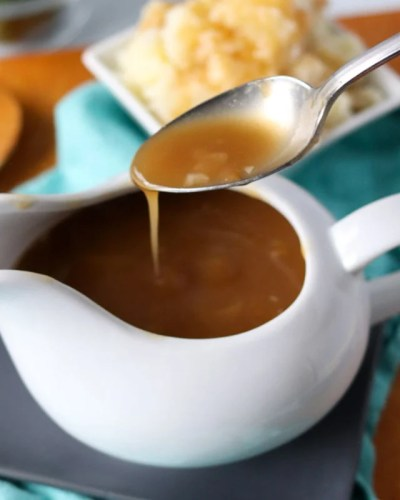 brown gravy dripping off a spoon