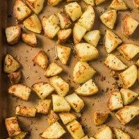 overhead shot of roasted potatoes on baking sheet