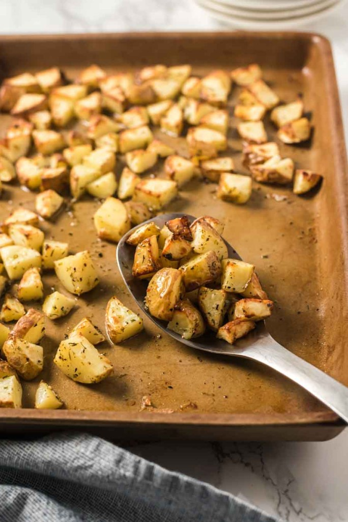 roasted potatoes on serving spoon