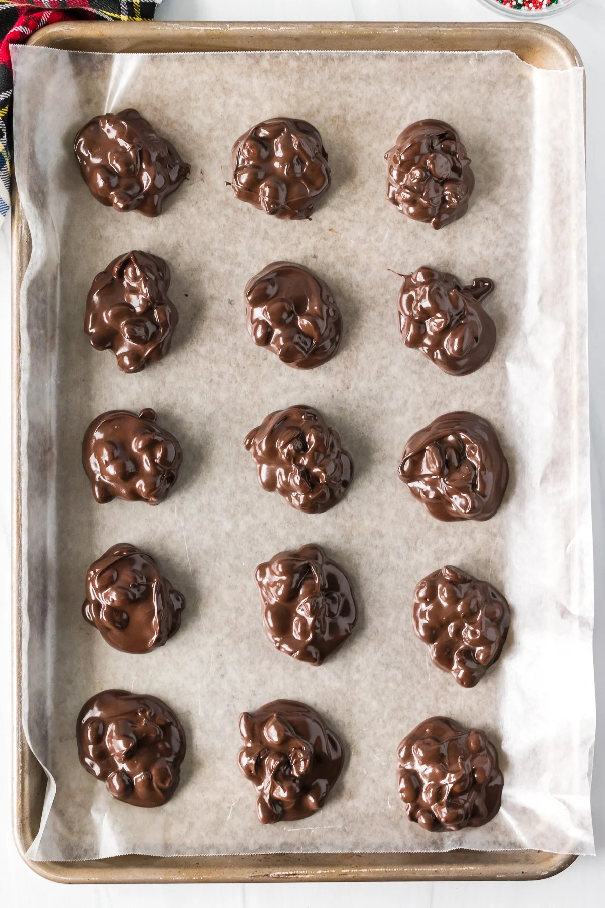 overhead shot of baking sheet with chocolate clusters
