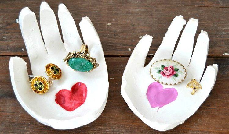 clay jewelry holder in the shape of a hand