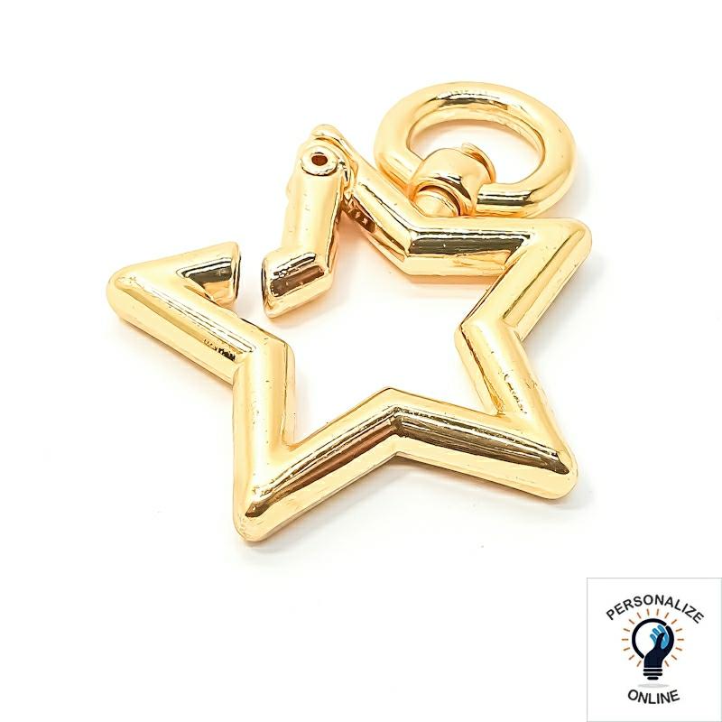 Estrela mosquetão dourada