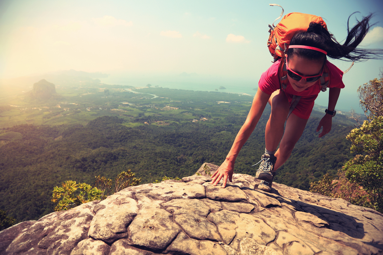 What would you do with a little more energy? Be like this hiker climbing rock on mountain peak cliff?