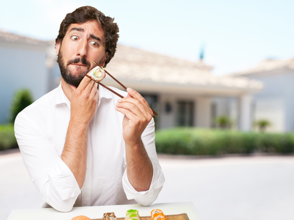 A man looks fearfully at his high glycemic index sushi an example of which health foods make fat.