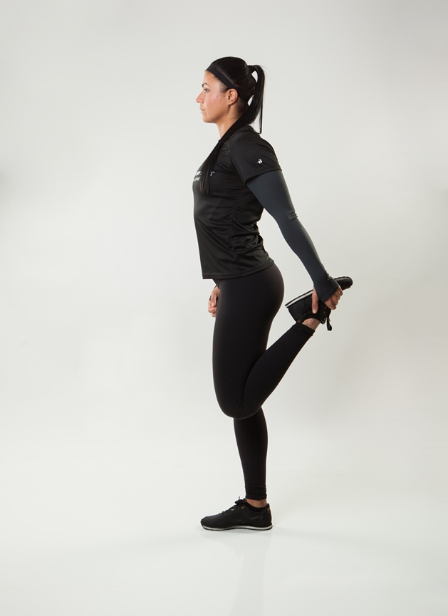 A standing quad stretch will help stretch your hip flexors which can shorten and cause back pain.