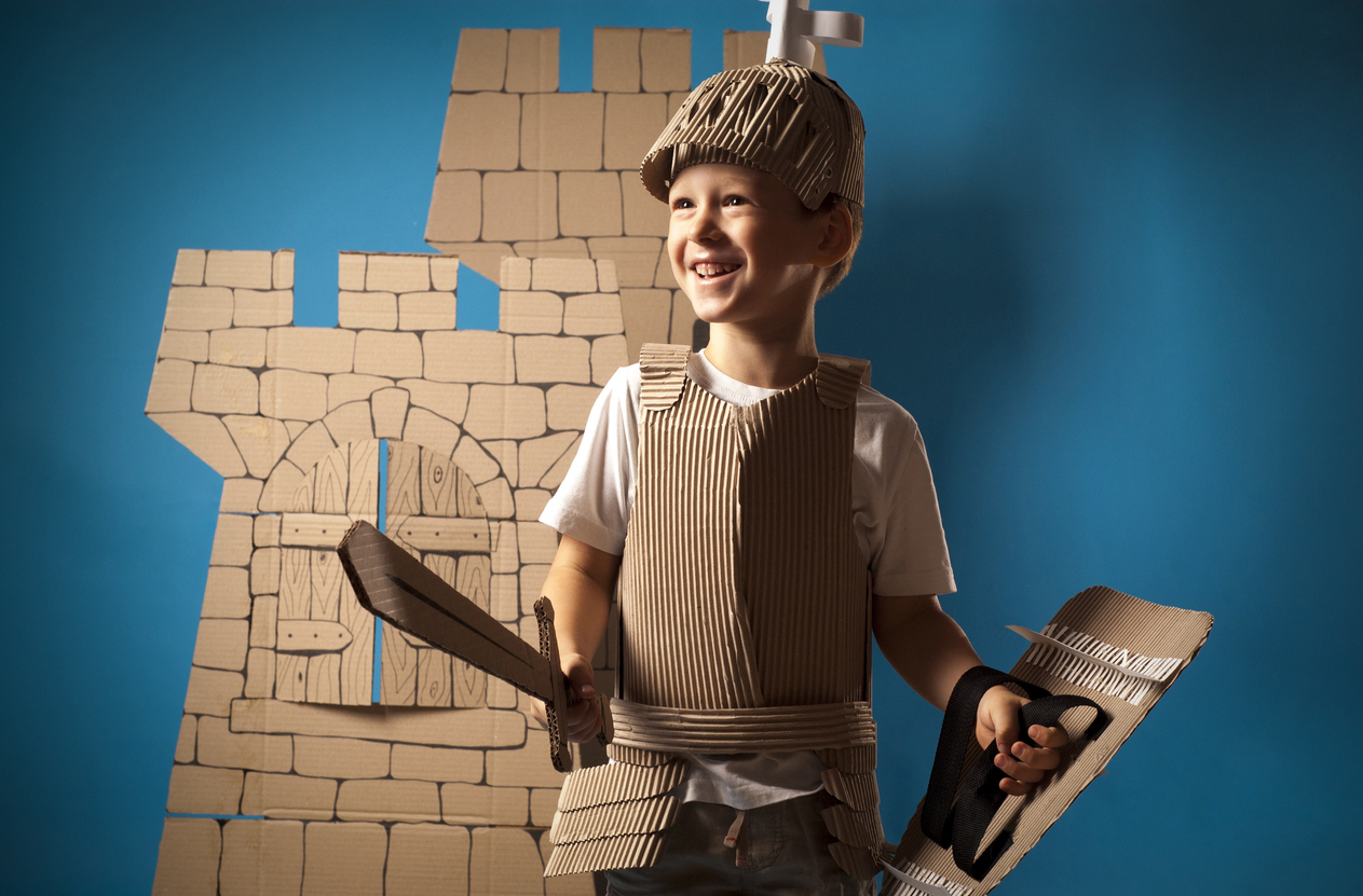 Photo of the boy in medieval knight costume made of cardboards.