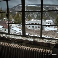A Place to Sit and Stare - Looking out of a broken window in an abandoned mining town.