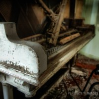 Play Me a Tune - Remains of a piano at an abandoned mining cabin