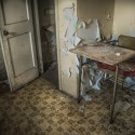 Sorry, the Pantry is Empty - Vintage highchair in an abandoned kitchen.