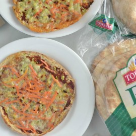 Satisfy a pizza craving with this no knead homemade recipe. Using pita bread, create individualized pita pizza pies by layering on your favorite toppings.