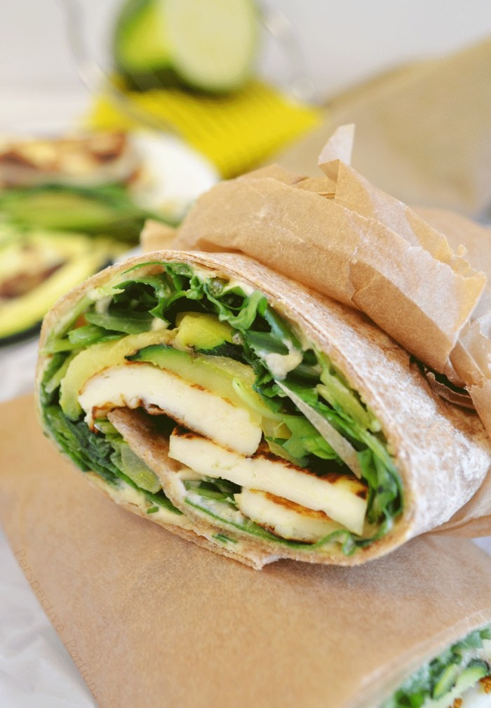 Grilled halloumi cheese, hummus, and lots of green vegetables wrapped up in a protein packed Mediterranean inspired breakfast wrap.
