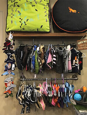 doggie clothes on a rack