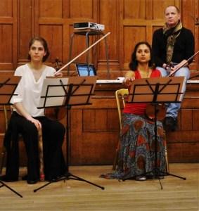 Composer. violinists. Nigel Clarke, Julia Pusker, Preetha Narayan