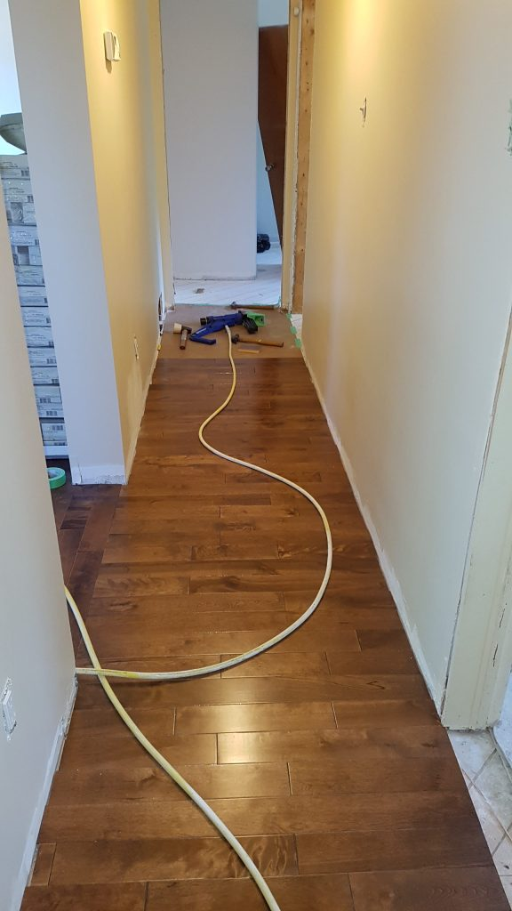 Hallway, new floors in the process of being installed