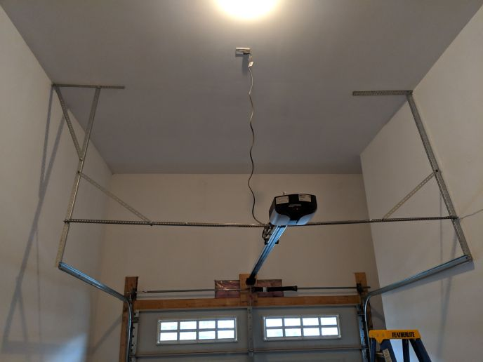 Garage opener installed, some modifications to strengthen existing door structure made