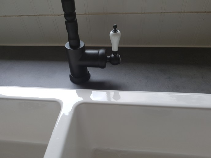 New counter top cut and faucet installed