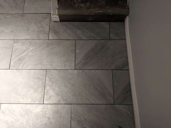 Tile floor installed in basement