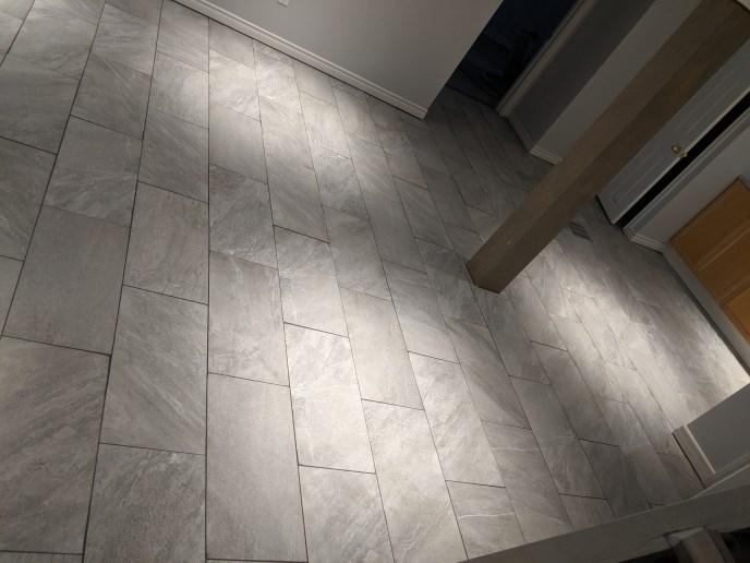 Tiles installed in basement