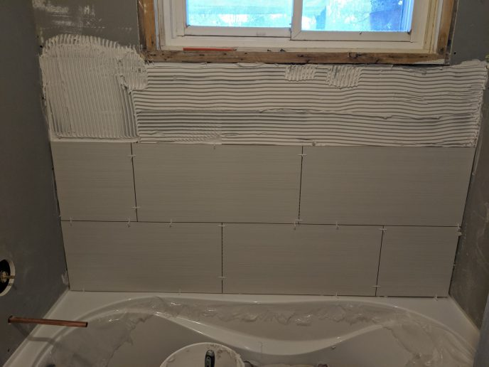 Tiles in the process of being installed