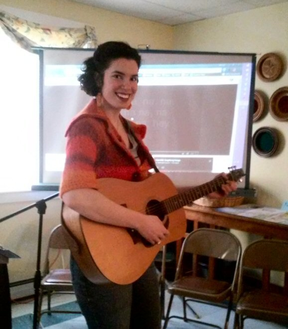 Pastor Lourey is ready with her guitar