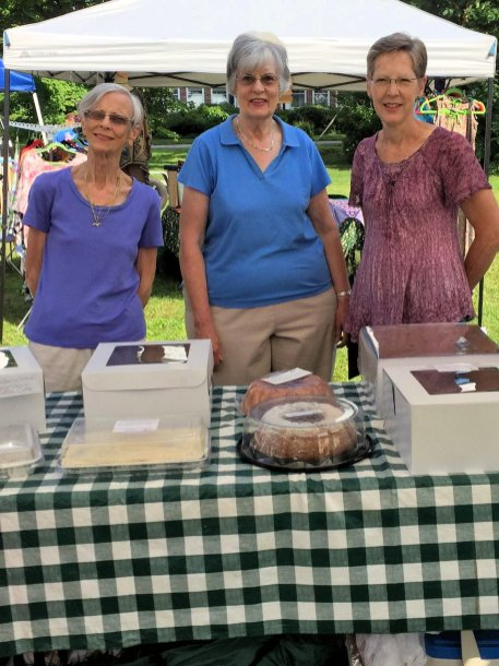 Sue Carol and Pam selling cakes