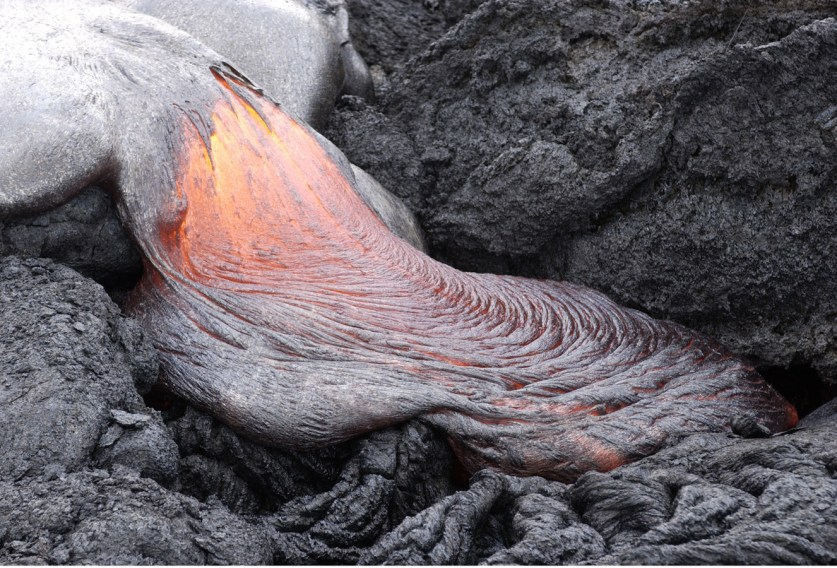An active lava flow takes on a ropy form. BYU students collected fresh lava samples from flows like this one as part of geology professor Jeffery R. Keith's scientific research. Photography by Mark A. Philbrick