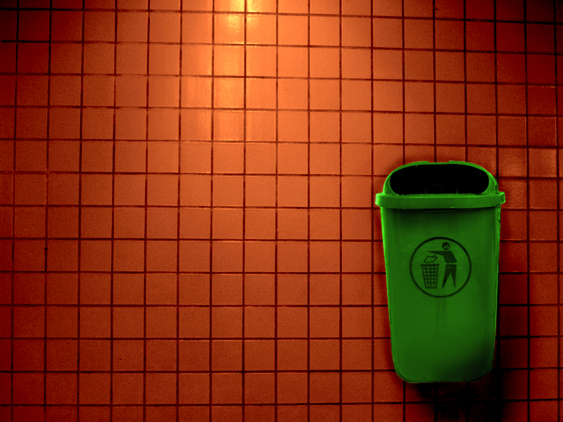 Bin hanging on a wall in a Metro station