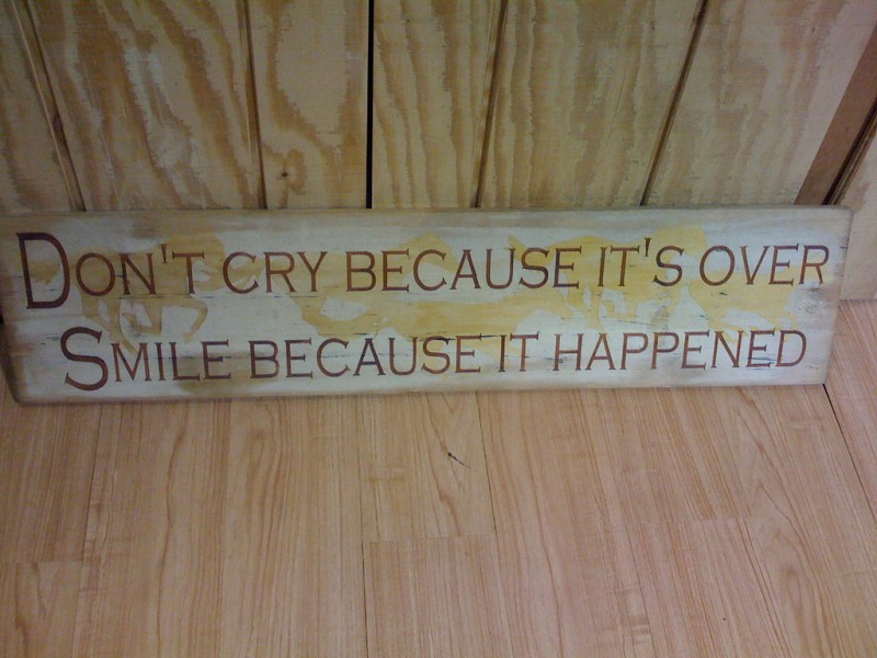 Sign saying 'Don't cry because it's over. Smile because it happened', which you might tell yourself after a disappointing date