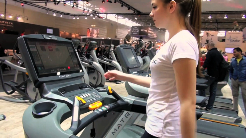 Girl on a treadmill in the gym