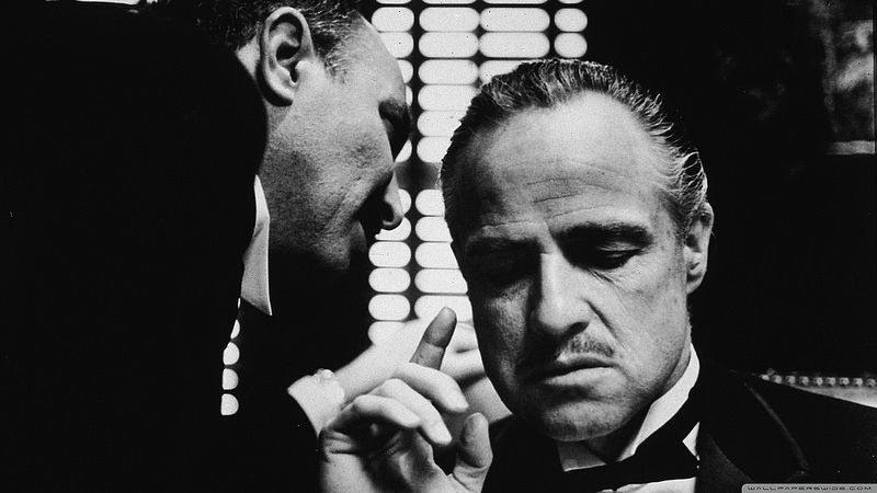 A black and white shot of the famous renegade of the acting world, Marlon Brando, starring in the Godfather