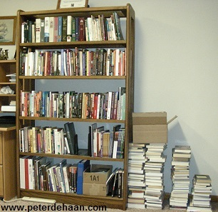 Overflowing book shelves