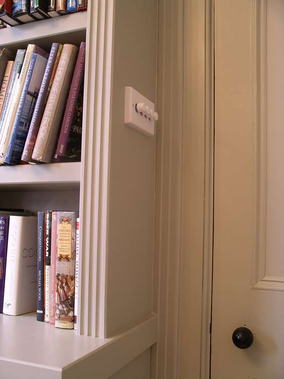 custom built music room bookcase and equipment storage