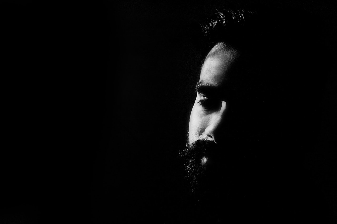 black and white shot of a bearded man